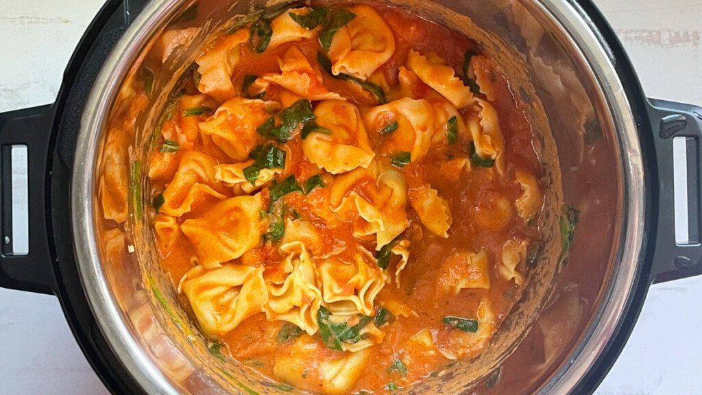 Ready Cheese Tortellini in the instant pot with some chopped spinach