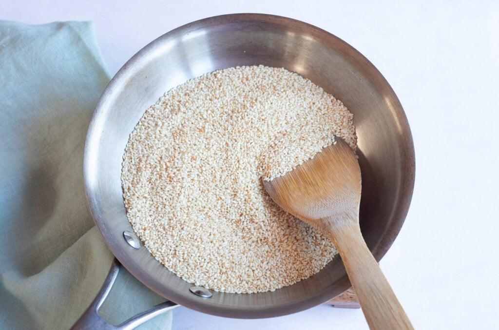 Roasting sesame seeds in a pan