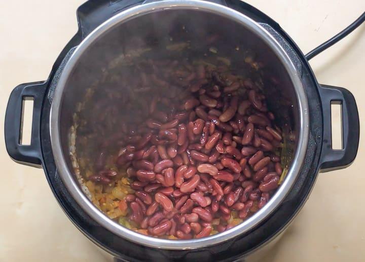 Add soaked red beans to make Rajma Masala