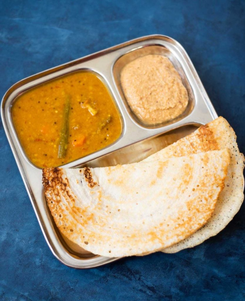 Dosa with sambar and chutney in a steel plate