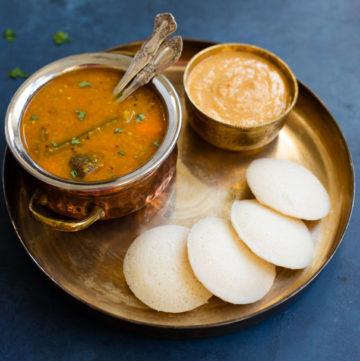 Idli served with sambar and chutney