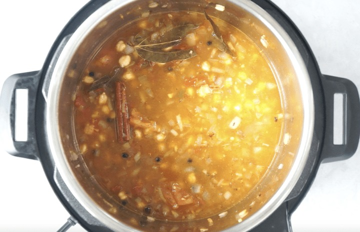 Chole Recipe Step 4 - Add chickpeas and water in pressure cooker