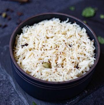 cumin rice in a black bowl