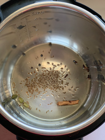 Whole spices in ghee in the instant pot