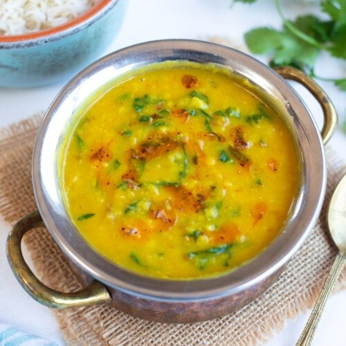 Dal Palak in a pretty bowl topped with tempering