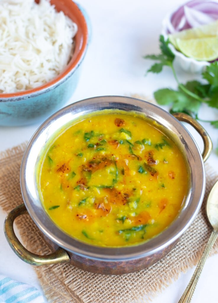Dal Palak (Lentils with spinach) in a pretty bowl with rice on the side