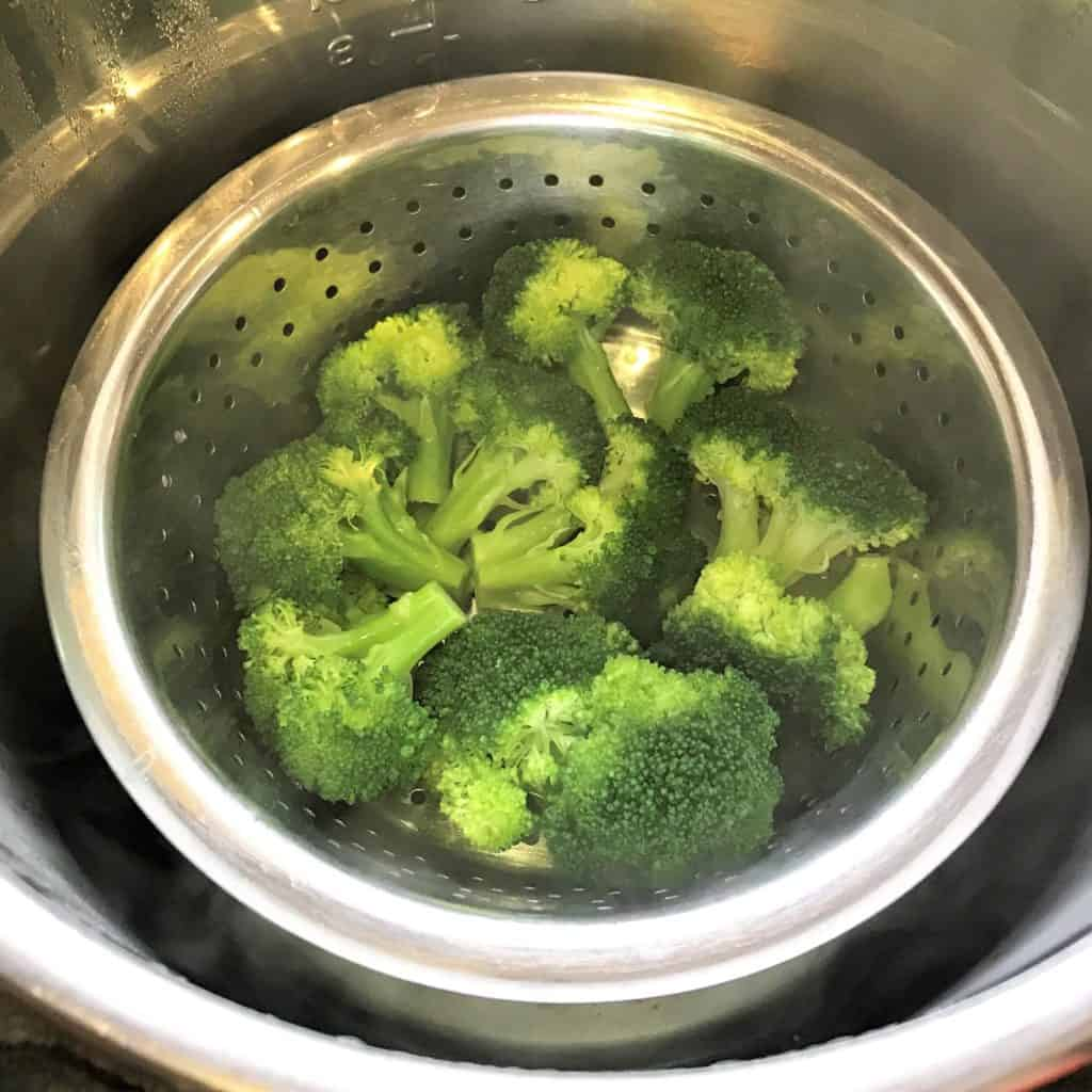 Steamed Broccoli Instant Pot Pressure Cooker in basket