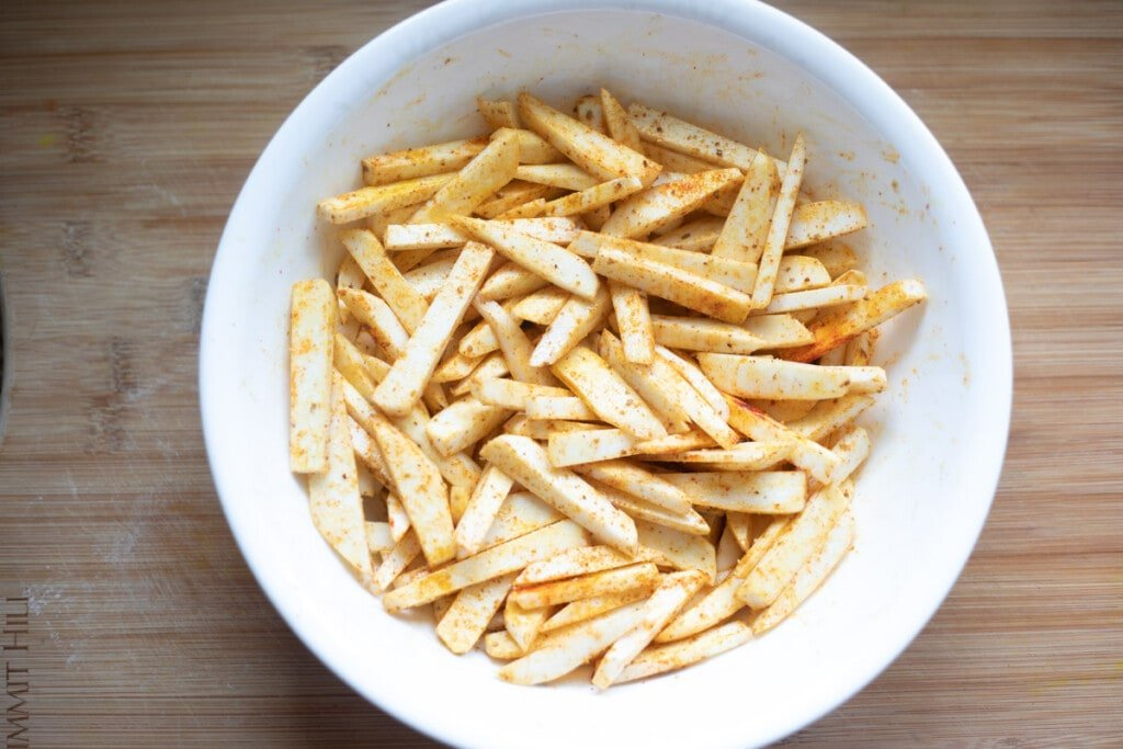 Taro fries covered with spices and oil