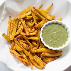 Taro fries in a bowl with a cilantro dip
