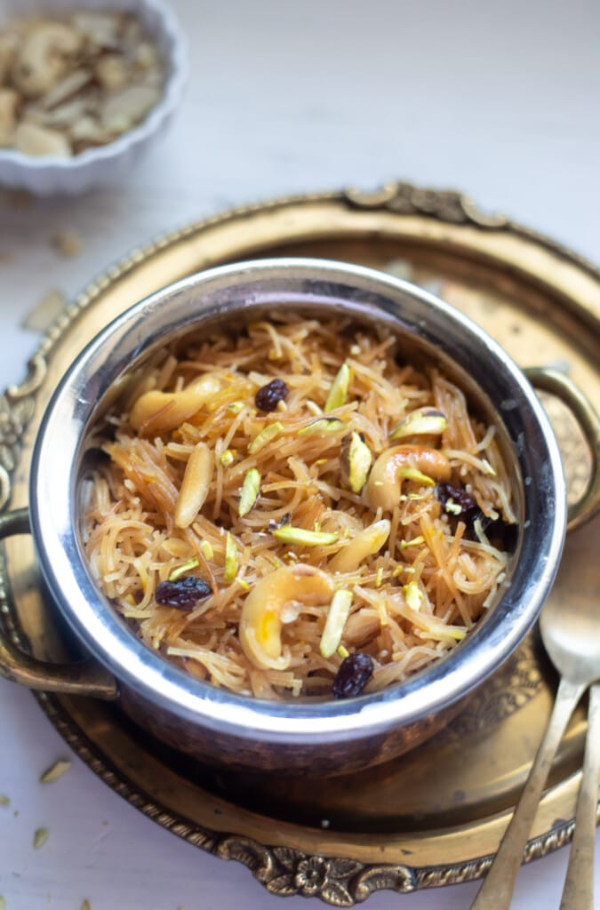 Dry Sweet Vermicelli Seviyan in a pretty bowl garnished with nuts and raisins
