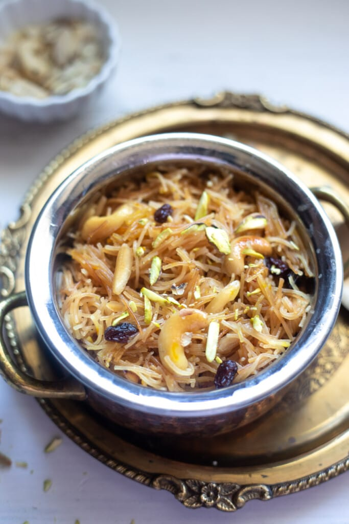Meethi Seviyan served in a pretty bowl topped with nuts and raisins