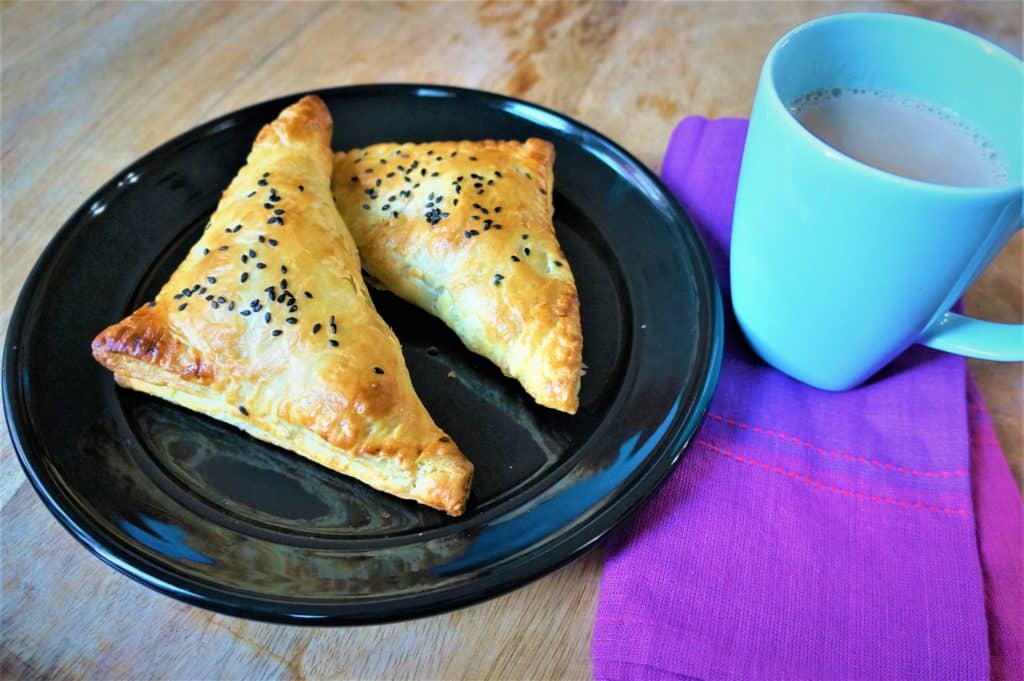 Paneer Puff Pastry Turnovers Air Fryer - A flaky golden crust with spicy flavorful paneer filling. Perfect appetizer for a party that can be prepared ahead of time. So easy and delicious!