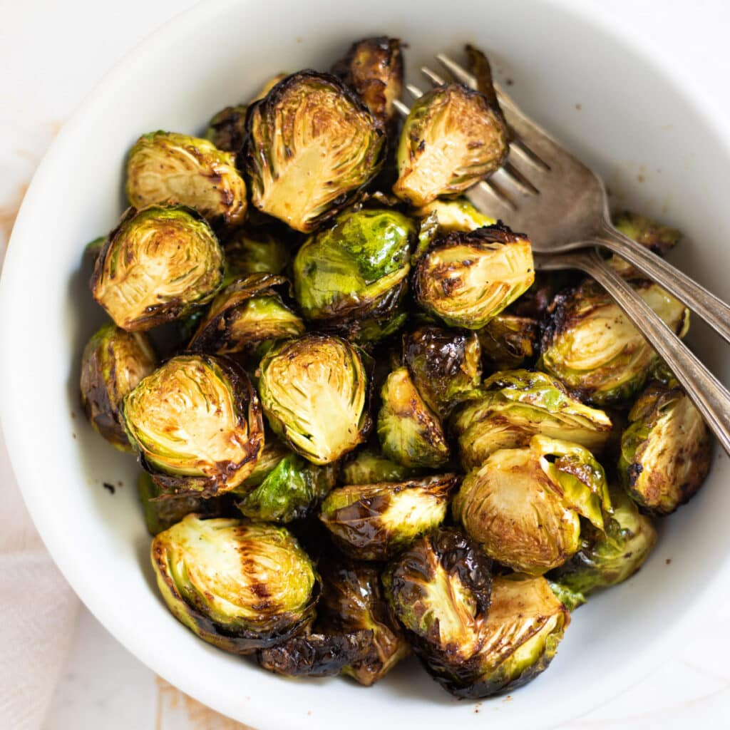 Roasted Air Fryer Brussels sprouts in a white bowl