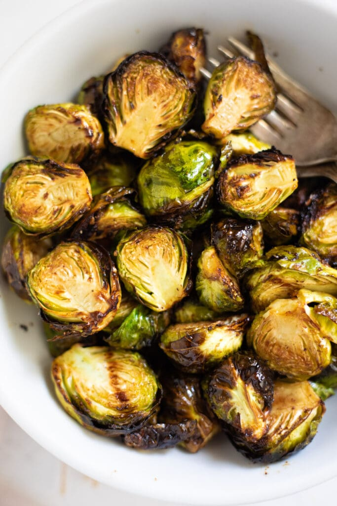 Brussels sprouts with balsamic vinegar in a white bowl