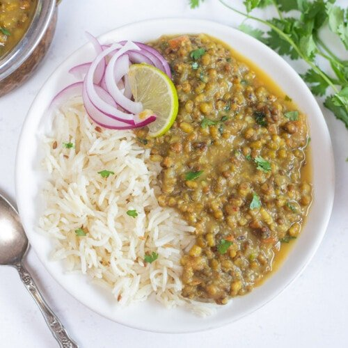 Green Moong Dal with rice topped with onions and lime