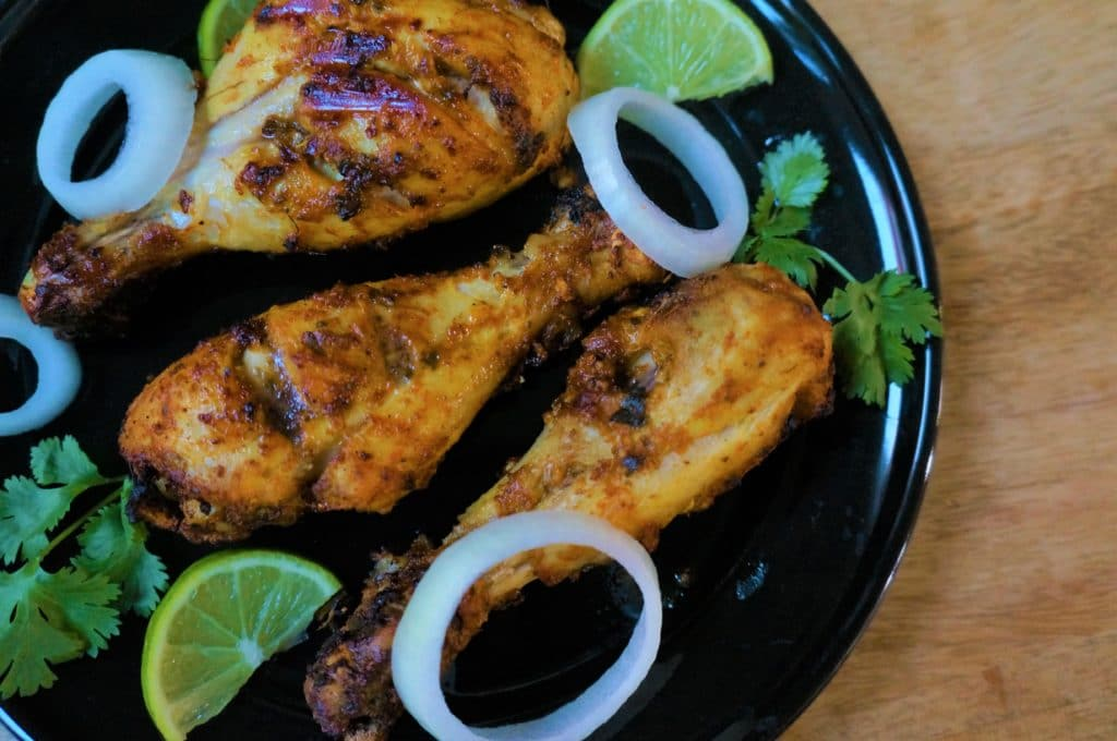 A flavor packed spicy dish from the Indian subcontinent popular all over the world. Chicken is marinated in yogurt, ginger, garlic, spices and lemon juice, then grilled in the air fryer or oven.