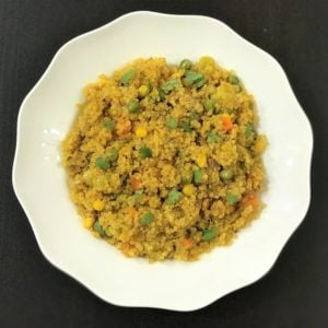 Quinoa with vegetables in a white bowl