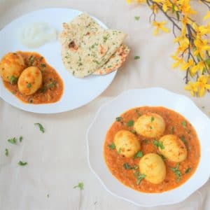 Egg currymade by adding boiled eggs to a spicy curry sauce, along with coconut milk to balance the flavors. In this Instant Pot Egg Curry, we will make the curry sauce and boil the eggs together. Make this quick and delicious Egg Curry for dinner on busy days in under 30 minutes. Serve it with roti, naan or rice.   #eggcurry #instantpot #pressurecooker #eggs #curry #lowcarb #glutenfree   pipingpotcurry.com
