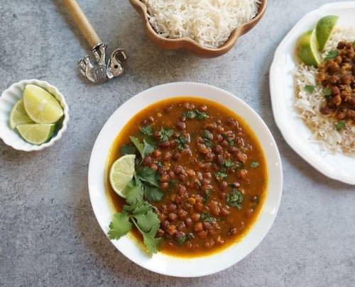 Kala Chana / black chickpea curry in a white bowl
