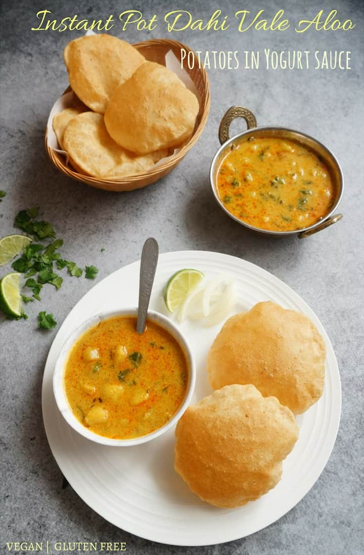Potato Curry in Yogurt Sauce or Dahi Vale Aloo - An easy and delicious comfort food with minimal ingredients made in the Instant Pot. This curry is made with just two main ingredients, potatoes and yogurt, tempered with cumin seeds, ginger and flavorful spices. Enjoy it with puri, paratha or rice for a satisfying meal | #aloo #potato #yogurt #curry #instantpot #pressurecooker | pipingpotcurry.com