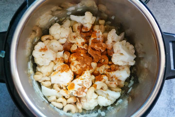 Onions, Cauliflower, Cashews and Spices in Instant Pot to make Turmeric Cauliflower Soup