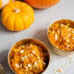 Coconut Pumpkin Halwa, also called as Kaddu ka Halwa is an Indian pumpkin dessert made with pumpkin, sugar, ghee, coconut and nuts. It can be cooked in a pressure cooker on the stovetop or Instant pot and takes less than 30 minutes to make this delicious dessert! #pumpkinhalwa #pumpkinpudding | pipingpotcurry.com