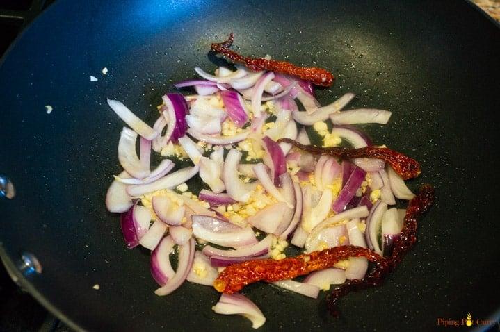 Garlicky Chili Potatoes - Step 1 Saute onions, garlic and red chili pepper