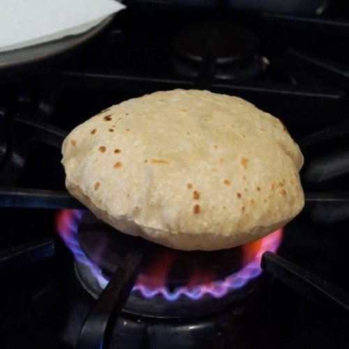 soft roti being cooked