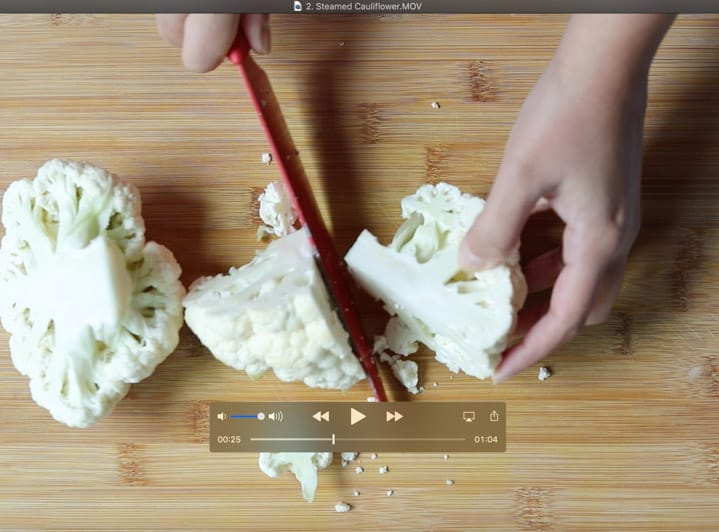 How to cut cauliflower step 2 divide into quarters