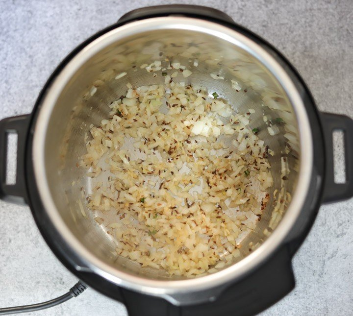 Whole Masoor Dal in Instant Pot Step 1 Sauté onions