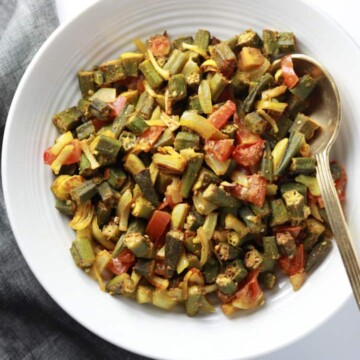 Baked Bhindi or Oven roasted okra in a white bowl