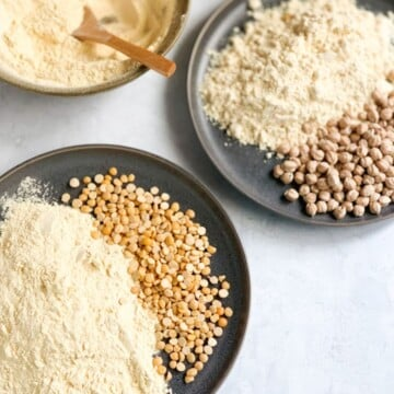 Chickpeas and chana dal with chickpea flour in two gray plates along with flour in a bowl