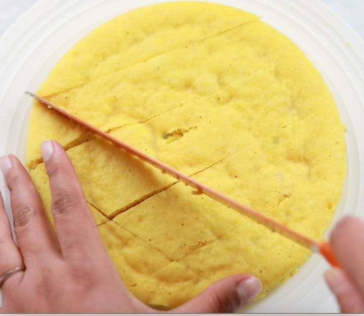 Cutting Khaman dhokla with a knife