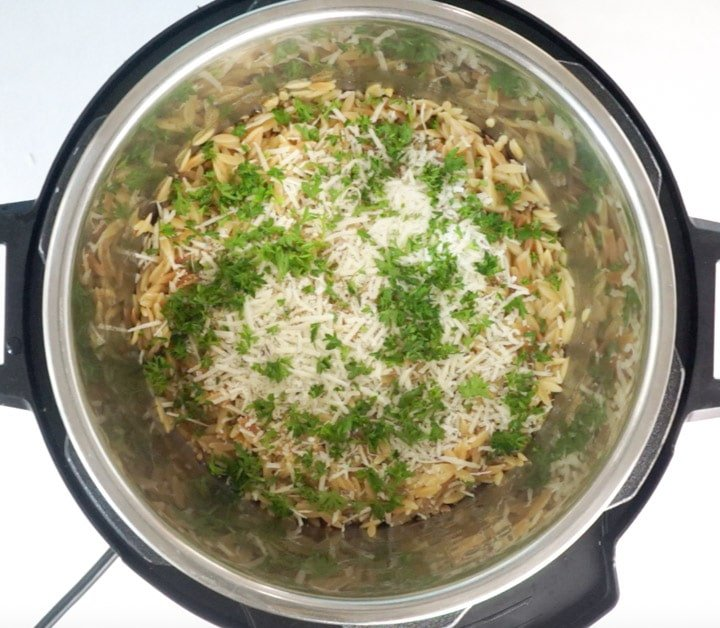 Parmesan and parsley over orzo pasta