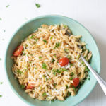 Lemon Parmesan Orzo with tomatoes in a green bowl