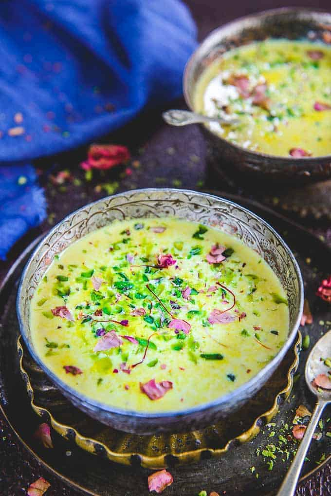Basundi topped with rose petals in a bowl