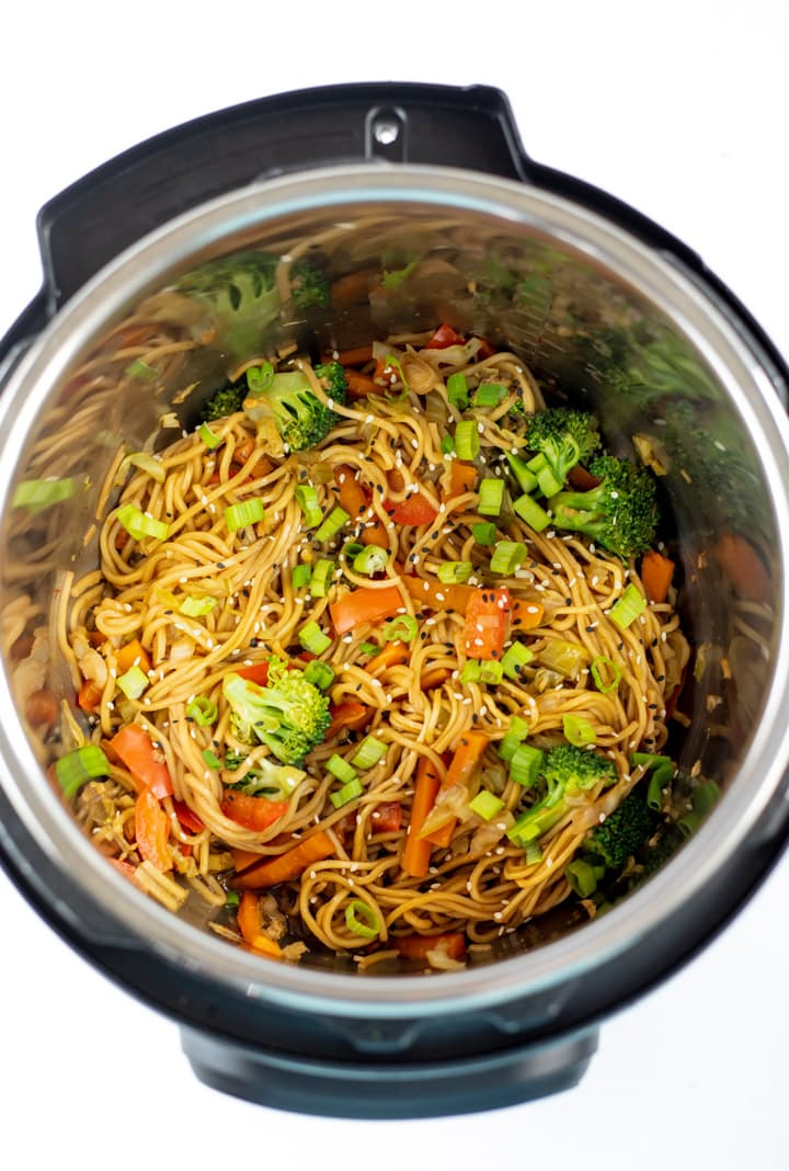 Overhead image of cooked vegetable lo mein inside an Instant Pot