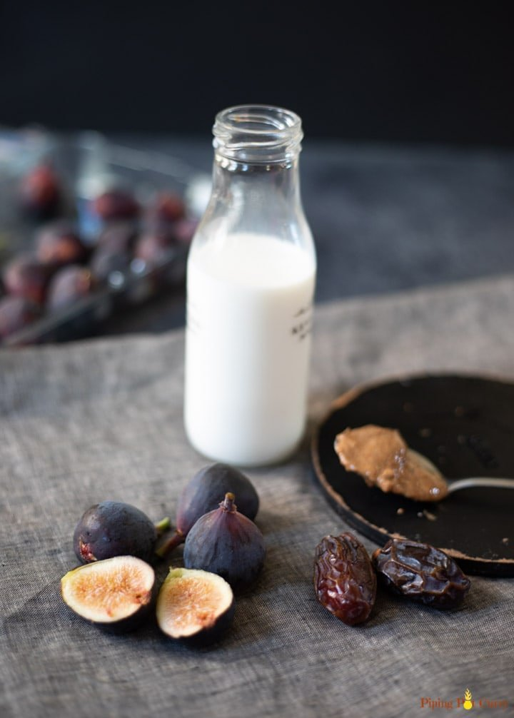 Ingredients to make a smoothie - figs, milk, dates, almond butter