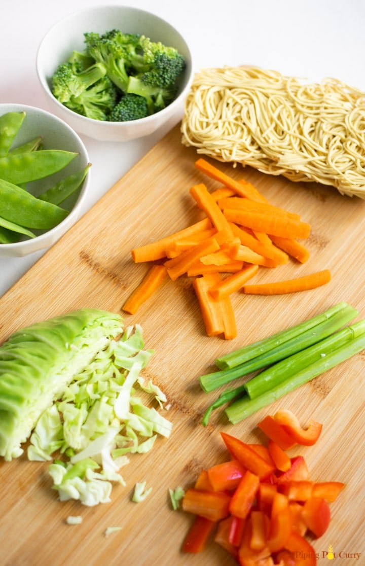 ingredients for Instant Pot vegetable Lo Mein on a cutting board
