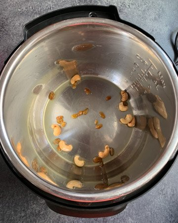 Saute cashews and raisins in instant pot