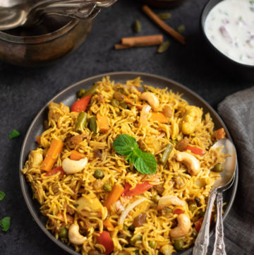 Vegetable Biryani Rice garnished with mint leaves