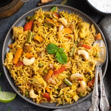 Vegetable Biryani Rice garnished with mint leaves and roasted nuts