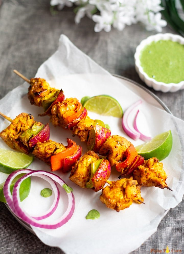 chicken and vegetable kebabs with red onion, lime, and dipping sauce
