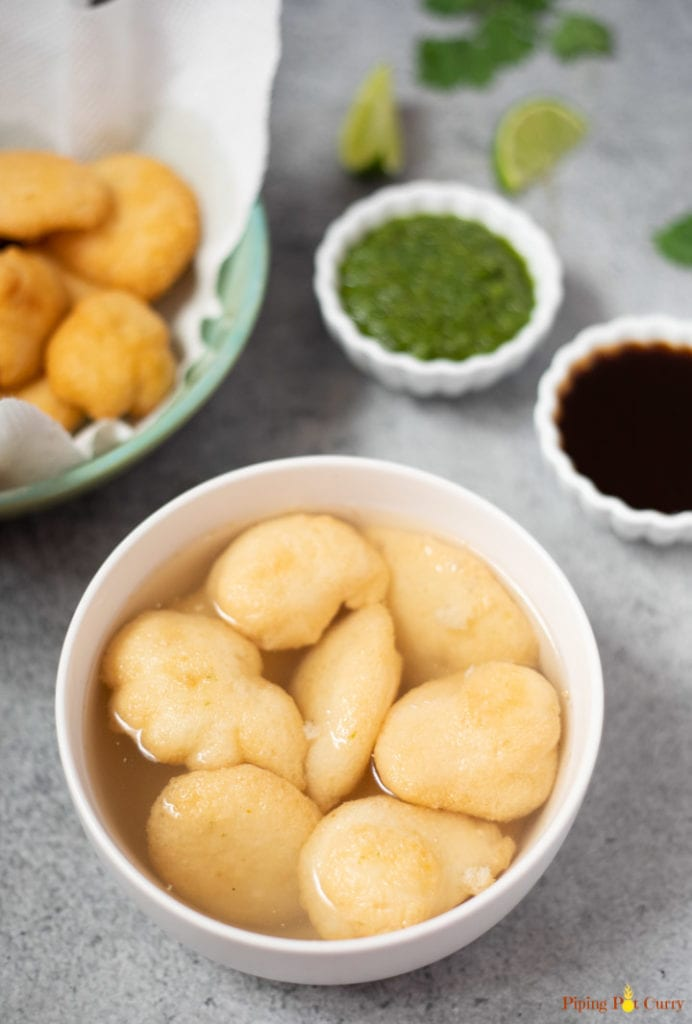 Lentil fritters (vada) soaked in water