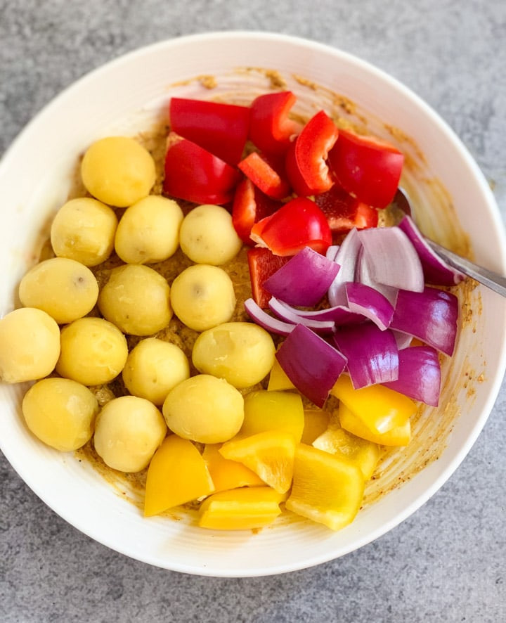 Potatoes, bell peppers and onions in a marinade