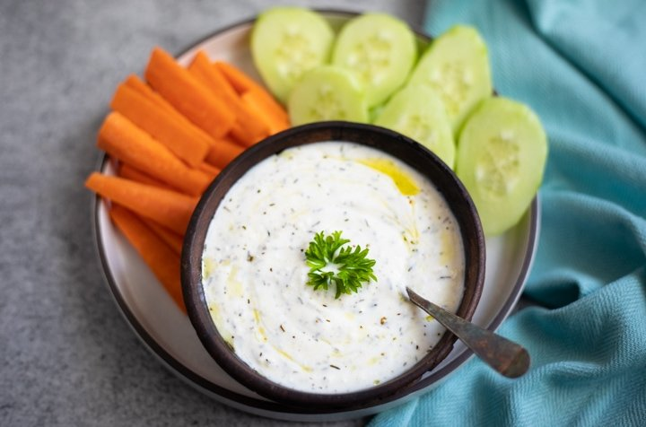 yogurt dipping sauce in a bowl with veggies to dip
