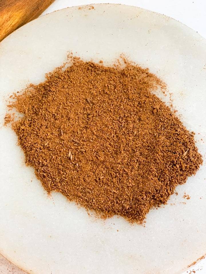 ground cumin on a marble base (chakla)