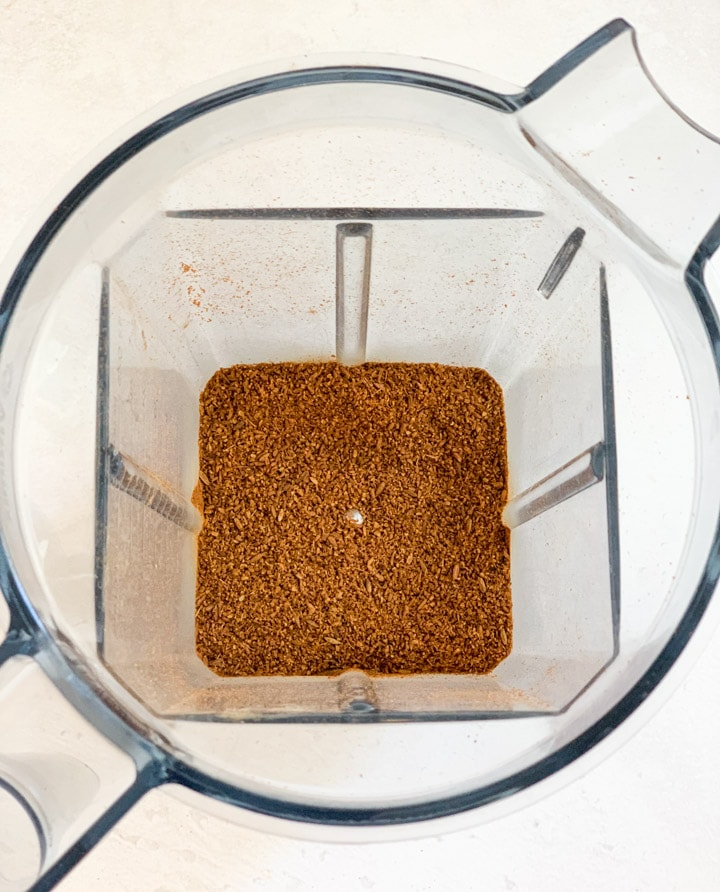 ground cumin in a grinder
