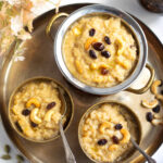 Sweet Pongal garnished with cashews and raisins served in bowls