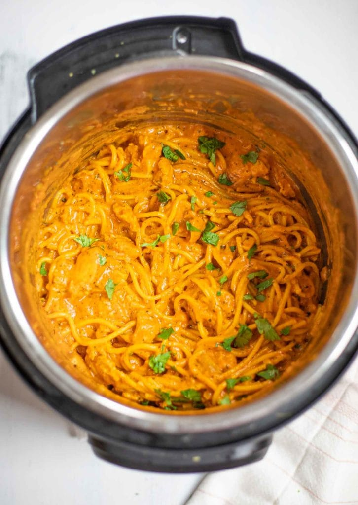 Creamy tikka masala pasta topped with cilantro in the instant pot